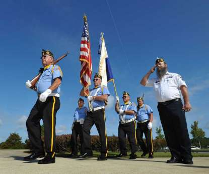 Will.Dickey@jacksonville.com Members of the Color Guard from American Legion Post 137 march at the beginning of Saturday's ceremony to dedicate the American Legion Family Monument at the Jacksonville National Cemetery.