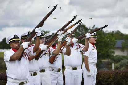 Will.Dickey@jacksonville.com Members of the Beaches Honor Guard fire a gun salute during the dedication of the American Legion Family Monument Saturday.