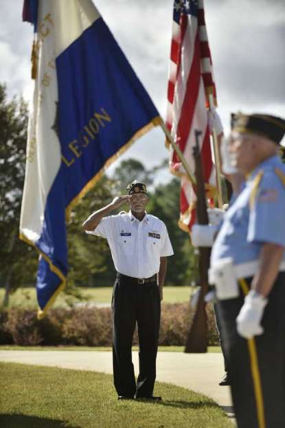 Will.Dickey@jacksonville.com Members of the Beaches Honor Guard fire a rifle salute during Saturday's dedication.